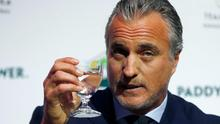 Former footballer David Ginola speaks at a press conference where he announced his campaign to stand for the FIFA presidency. Photo: AP Photo/Alastair Grant