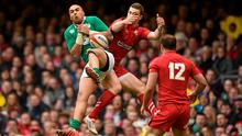 Simon Zebo, Ireland, contests a high ball with George North, Wales
