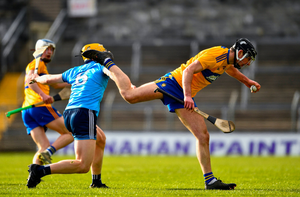Cathal Malone of Clare wins possession ahead of Dáire Gray of Dublin. Photo by Ray McManus/Sportsfile