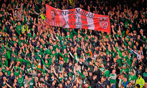 Ireland supporters hold aloft a banner in commemoration of the Derry captain. Photo: Sportsfile