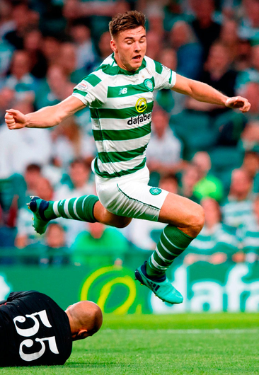 FLYING FORM: Celtic's Kieran Tierney in action against Alashkert during the UEFA Champions League match at Celtic Park. Photo: Robert Parry/PA