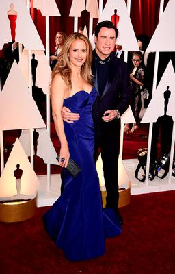 John Travolta and wife Kelly Preston  arriving at the 87th Academy Awards held at the Dolby Theatre in Hollywood, Los Angeles, USA. PRESS ASSOCIATION Photo. Picture date: Sunday February 22, 2015. See PA story SHOWBIZ Oscars. Photo credit should read: Ian West/PA Wire