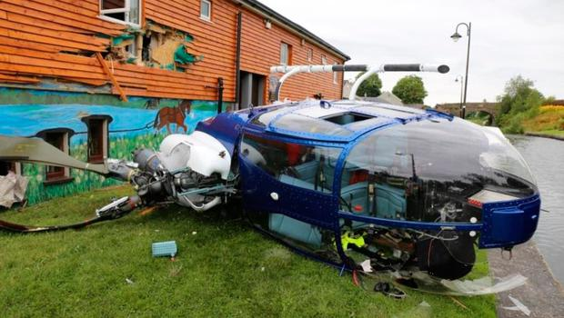 The helicopter lies on its side beside the Rustic Inn in Abbeyshrule, Co Longford