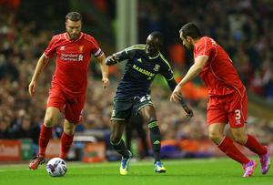 Middlesbrough's Albert Adomah vies for possession with Liverpool pair Rickie Lambert and Jose Enrique of Liverpool during the Capital One Cup clash at Anfield. Photo: Alex Livesey/Getty Images