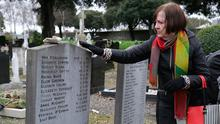 Mary Merritt touches a headstone in memory of the Magdalenes in Glasnevin cemetery. Photo: Damien Eagers