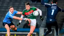 Cillian O'Connor of Mayo about to have his shot at goal blocked by Dublin goalkeeper Stephen Cluxton as Philly McMahon approaches. Photo: Brendan Moran/Sportsfile