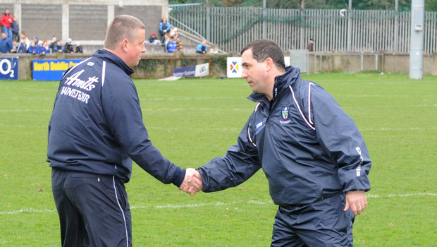 Paul 'Pillar' Caffrey and Séamus McEnaney shake hands before throw-in