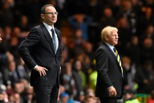 Martin O'Neill watches the action from the touchline at Parkhead with his Scottish counterpart Gordon Strachan in the background