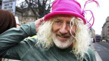 Mick Wallace TD tries on a protester's hat at the Aer Lingus  pensioner protest at Leinster House. Photo: Tom Burke