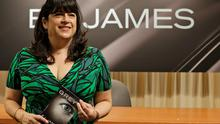 Author EL James poses for photographers before signing her new book, Grey, at a Barnes and Noble bookstore in New York, on Thursday (AP Photo/Mary Altaffer)