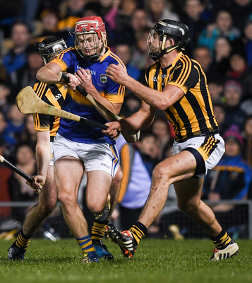 Tipperary's Sean Curran in action against Conor O'Shea, right, and Jason Cleere of Kilkenny. Photo: Ray McManus/Sportsfile