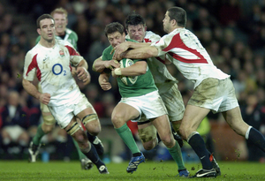 Ireland's Ronan O'Gara is tackled by England's Martin Corry and Andy Farrell. Photo: Brendan Moran / SPORTSFILE