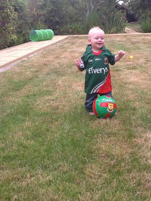 Shouting for Mayo, Nathan O'Neill - living in Chingford, London but travelling to Swinford in Mayo to watch the match with his parents Martin and Noelle