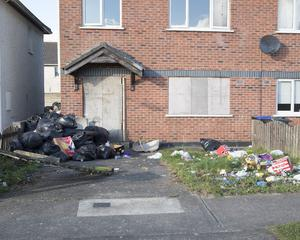 Bin bags are continuously being dumped in front of the disused house Photo: Thomas Nolan Photography