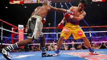 Floyd Mayweather, Jr. of the U.S. lands  punch against Manny Pacquiao of the Philippines (R) in the ninth round during their welterweight WBO, WBC and WBA (Super) title fight in Las Vegas, Nevada, May 2, 2015.    REUTERS/Steve Marcus