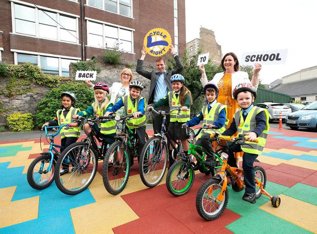 Isla Garvie (left) with Layla Bishti, Peter McKeagney, Orla Maguire Murphy, Jacob Butler O'Reilly and James Kelly with Moyagh Murdock, CEO of the Road Safety Authority; Geoff Liffey, CEO Cycling Ireland; and Marguerite Sayers, managing director ESB Networks at the launch. Photo: Robbie Reynold