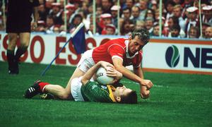 TAKE THAT: Conor Counihan of Cork and Meath's Bernard Flynn get up close and personal in the 1990 All-Ireland SFC final. Photo: Ray McManus / Sportsfile