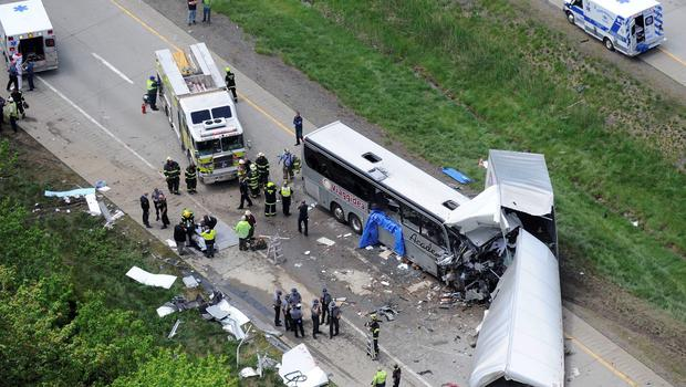 Authorities investigate the scene of a fatal collision between a tractor-trailer and a tour bus on Interstate 380 near Mount Pocono, Pa. Wednesday, June 3, 2015. (AP Photo/David Kidwell)