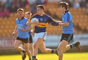 Tipperary's Jason Lonergan is closed down by Ross McGowan