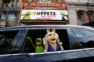 "The characters of Kermit and Miss Piggy arrive at the premiere of ""Muppets Most Wanted"" in Hollywood, California REUTERS/Mario Anzuoni/Files"
