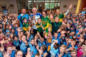 Friday 18 September 2015. St Colmcilles Senior NS, Knocklyon. Kerry teachers in their county colours, L to R: teacher Shane Durkin, Ballyboden and Dublin hurler, Asst. Principal Francie Connolly in his Monaghan colours, Principal Lynn Corcorans and on her left Noramai O'Sullivan surrounded by children from 3rd to 6th class.