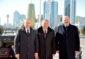 Kazakhstan's President Nursultan Nazarbayev (C), his Russian counterpart Vladimir Putin (L) and his Belarussian counterpart Alexander Lukashenko pose for a picture as they meet in Astana, March 20, 2015. The three main members of the Russian-led Eurasian Economic Union face a big economic challenge from the fall in global oil prices, Nazarbayev said on Friday. But, speaking before talks in the Kazakh capital Astana with Putin and Lukashenko, Nazarbayev said the situation had become more stable. REUTERS/Alexei Druzhinin/RIA Novosti/Kremlin ATTENTION EDITORS - THIS IMAGE HAS BEEN SUPPLIED BY A THIRD PARTY. IT IS DISTRIBUTED, EXACTLY AS RECEIVED BY REUTERS, AS A SERVICE TO CLIENTS.