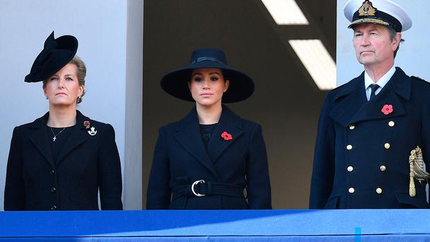 Britain's Meghan, Duchess of Sussex (C) flanked by Britain's Sophie, Countess of Wessex, (L) and Vice Admiral Timothy Laurence (R) looks on from a balcony as she attends the Remembrance Sunday ceremony at the Cenotaph on Whitehall in central London, on November 10, 2019
