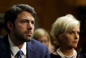 Actor, writer and director Ben Affleck (L) sits with Cindy McCain, wife of Senator John McCain (R-AZ), before testifying at the Senate Foreign Relations Committee on Capitol Hill in Washington February 26, 2014.   REUTERS/Gary Cameron  (UNITED STATES - Tags: POLITICS ENTERTAINMENT)