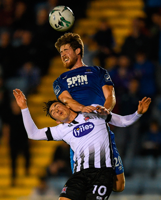 Dundalk's Jamie McGrath clashes with Sam Bone of Waterford during the Lilywhites' 1-0 league win last night. Photo: Sportsfile