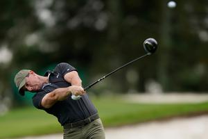 CHALLENGE: Rory McIlroy tees off on the third hole during a practice round for the Masters golf tournament in Augusta
