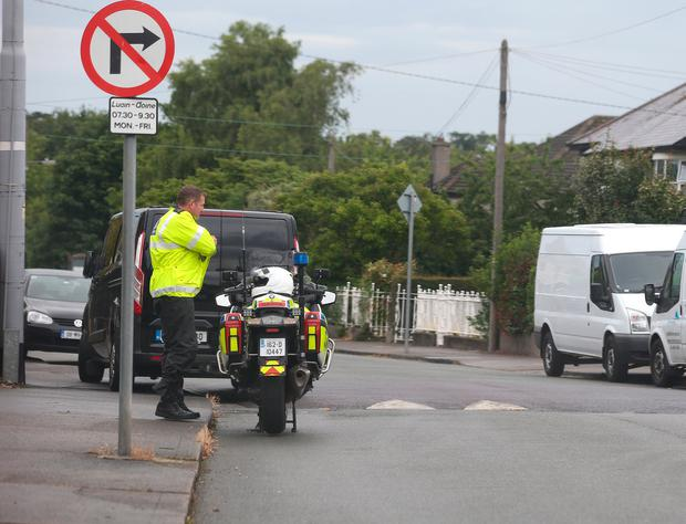 A Garda on Butterfield Park in Rathfarnham where a cyclist in his 50s died in a road traffic collision. Photo: Damien Eagers