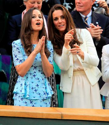 The Duchess of Cambridge and sister Pippa Middleton (left) attending the the Men's Singles Final during day thirteen of the 2012 Wimbledon Championships at the All England Lawn Tennis Club, Wimbledon
