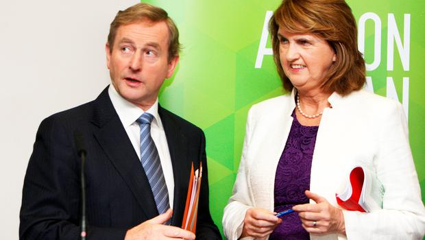Enda Kenny and Joan Burton: Labour claims credit for Kenny's moves on raising minimum wage and promising USC cuts
