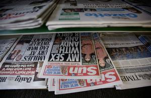 Newspapers, including The Sun, on sale in a newsagent in north London, after a topless woman appeared on Page 3 of The Sun newspaper for the first time in almost a week, bringing to an end speculation that the paper had dropped the long-running feature. Photo: PA