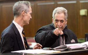 Robert Vineberg (R) points at a camera as defense attorney Edward Kratt looks on during his arraignment in court in New York February 5, 2014. Three men and one woman arrested in New York have been charged with drugs offences possibly connected to narcotics found at the home of film star Philip Seymour Hoffman following his death of an apparent heroin overdose, law enforcement officials said. REUTERS/Steven Hirsch/Pool   (UNITED STATES - Tags: ENTERTAINMENT CRIME LAW)