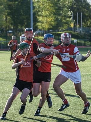 Ballinteer's Paddy Watchorn and Eoin Fitzpatrick surround Kevin Kirwan of Cuala