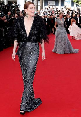 "Actress Julianne Moore poses on the red carpet as she arrives for the opening ceremony and the screening of the film ""La tete haute"" out of competition during the 68th Cannes Film Festival in Cannes, southern France, May 13, 2015.The 68th edition of the film festival will run from May 13 to May 24.       REUTERS/Regis Duvignau"