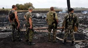 Armed pro-Russian separatists stand near the crash site of Malaysia MH17