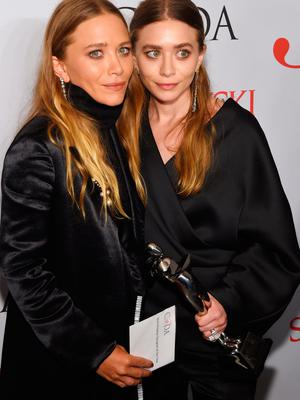 Mary-Kate Olsen and Ashley Olsen pose on the winners walk at the 2015 CFDA Fashion Awards at Alice Tully Hall at Lincoln Center on June 1, 2015 in New York City.  (Photo by Larry Busacca/Getty Images)