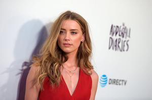 "Actress Amber Heard attends A24/DIRECTV's ""The Adderall Diaires"" Premiere at ArcLight Hollywood on April 12, 2016 in Hollywood, California.  (Photo by Jason Kempin/Getty Images)"