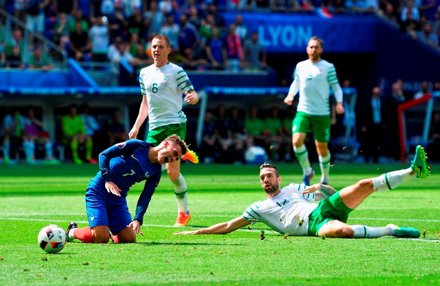 Shane Duffy fouls Antoine Griezmann, which resulted in a red card.  (Photo by Laurence Griffiths/Getty Images)