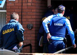Armed gardai at the scene of a raid on a house only hours after Gareth Hutch was shot dead