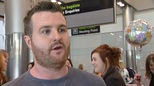 Barry Lyttle (33) was greeted by friends and family as he arrived in Dublin Airport after he received a suspended sentence for punching brother Patrick. Credit: BBC News Northern Ireland