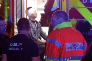 17/03/15.Firefighters attend to a man who was assaulted on Parliament Street Dublin on St.Patricks night. Pic: Justin Farrelly.