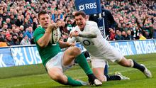 Robbie Henshaw of Ireland touches down the ball to score the opening try despite the efforts of Alex Goode of England during the RBS Six Nations match between Ireland and England at the Aviva Stadium on March 1, 2015 in Dublin, Ireland