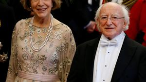President of Ireland Michael D Higgins and his wife Sabina arrive to attend a banquet in the President's honour in London on Wednesday