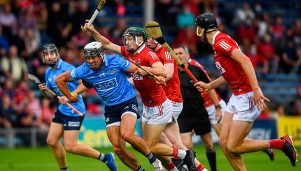 Cian Boland of Dublin breaks away from Mark Coleman of Cork at Semple Stadium. Photo by David Fitzgerald/Sportsfile