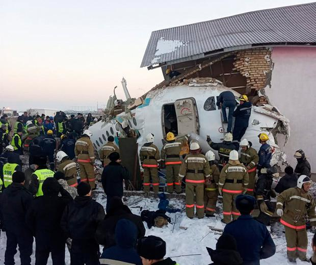 Devastation: Police and rescuers work at the site of the plane crash near Almaty International Airport, Kazakhstan. Emergency Situations Ministry of the Republic of Kazakhstan photo via AP