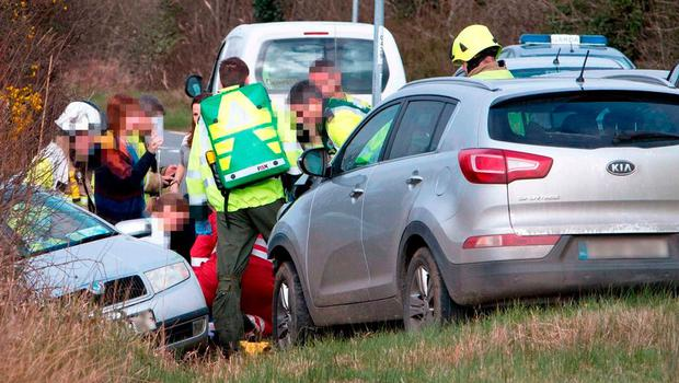 Emergency services tend to a victim at the scene of the crash near Ballyea, Co Clare. Photo: Press 22