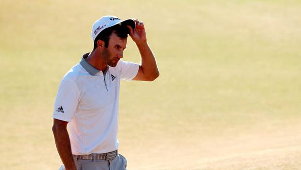 Dustin Johnson of the United States walks off the 18th green after making par during the final round of the 115th U.S. Open Championship at Chambers Bay